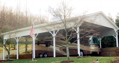 24'x60' Custom Carport with White Vinyl Siding / Metal Roof.  Options Shown:  Cupola / Decorative Braces / Metal Ceiling