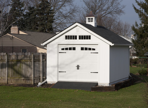 12'x20' Garage with White Vinyl Siding and Trim / Black Shingles.  