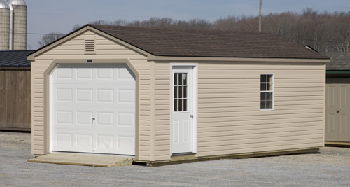 12'x24' Garage with Tan Vinyl Siding / Clay Trim / Slate Shingles.  Options Shown:  Ramp / 9 Light Door / Vinyl Gable Vents